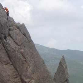 Another party climbing the pink slab on First Pinnacle Rib
