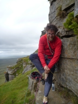 Alasdair, sheltered from the wind at the base