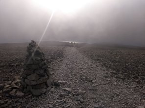 Eery light descending the tourist path from the summit