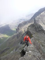 Josh enjoying good exposure on the inaccessible pinnacle